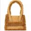 Jacquemus Le Chiquito Moyen táska  A Jacquemus 'Le Chiquito' fantázianévre hallgató táskája tette világszerte népszerűvé a márkát - ezt a szőrmés mini-verziót viszont nem kapkodják el a boltok polcairól a divatrajongók, nem is értjük miért. Egyébként 249 ezer forintba kerül.